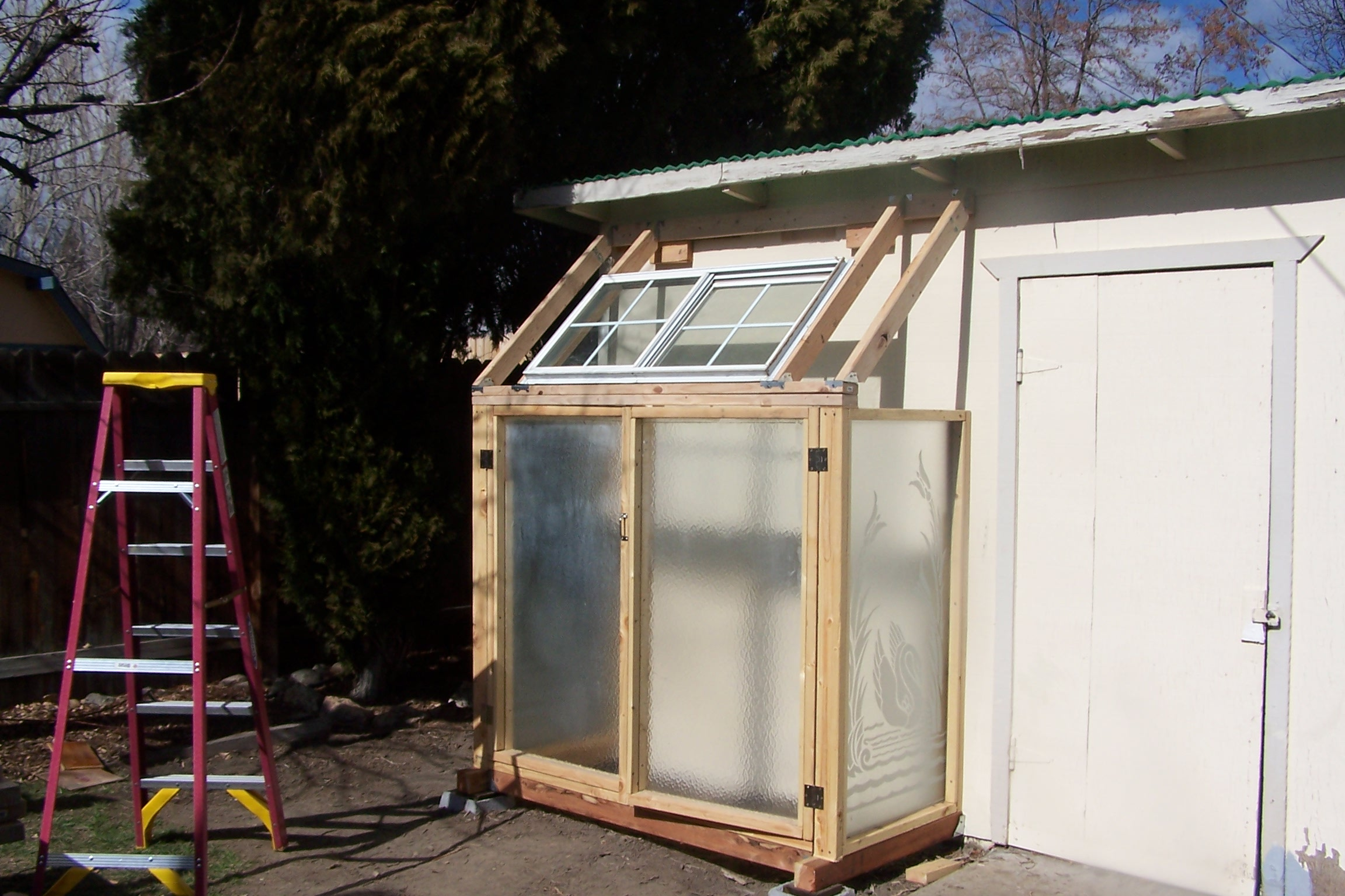 Building A Greenhouse From Recycled Shower Doors The
